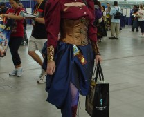 Being awake way too early didn't stop this cosplayer from smiling brightly for the camera!