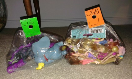 $1.30 of thrift store toys (following discounts but before tax). What lies within these dusty plastic bags?